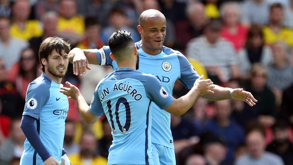 SMILES ALL ROUND: Kompnay and Aguero embrace to celebrate City's opener.