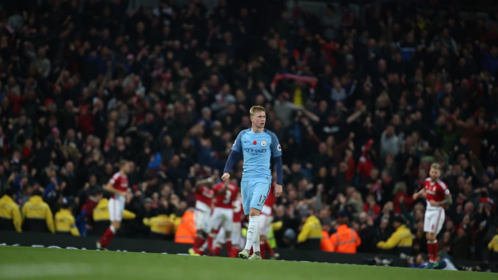 DE BRUYNE DESPAIR: Middlesbrough celebrate their last minute goal as the abject De Bruyne walks away.