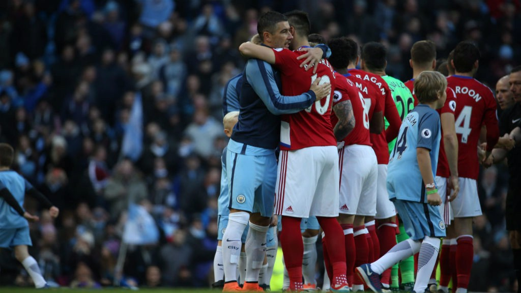 WARM WELCOME: Aleksandar Kolarov and Alvaro Negredo embrace before kick-off.