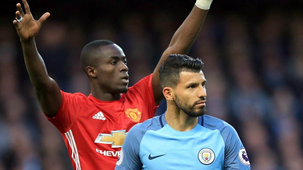 TIGHT MARKING: Eric Bailly pays close attention to Sergio Aguero in the first half.