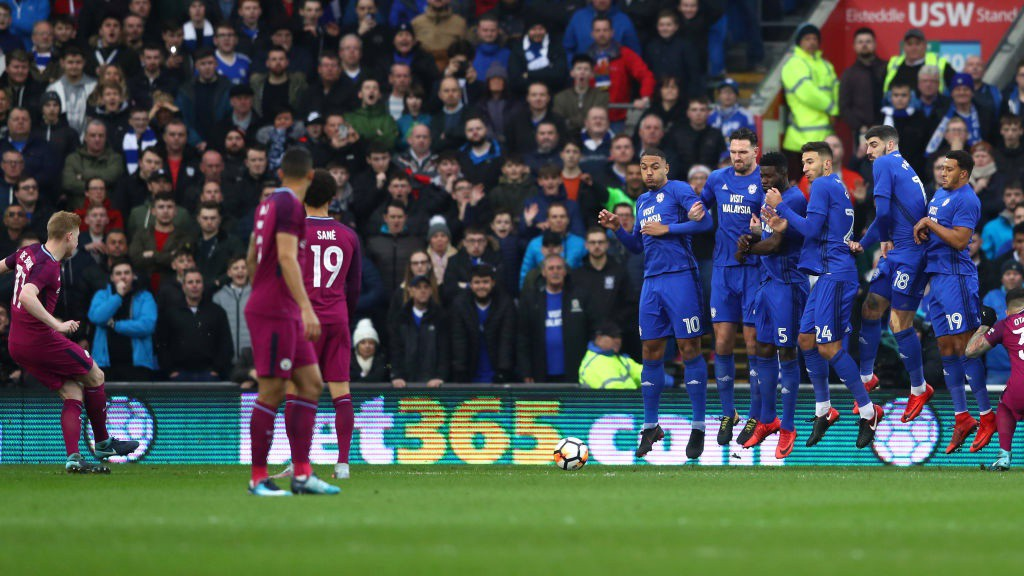 UP AND UNDER: Kevin De Bruyne leaves Cardiff's wall perplexed with a wonderful free kick.