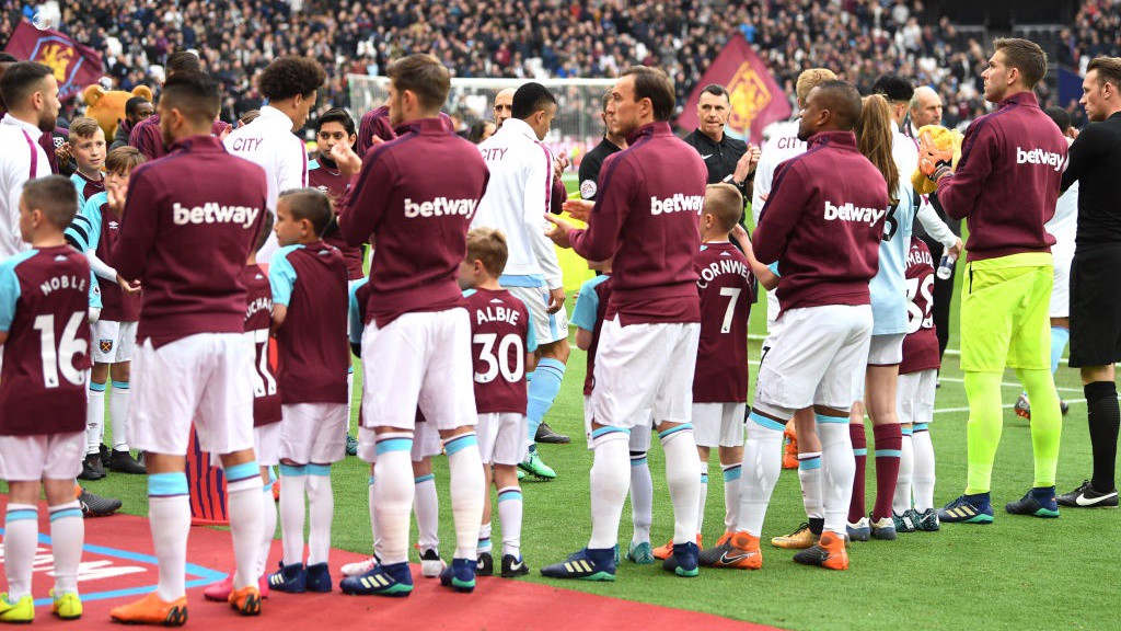 CHAMPIONS: The Premier League winners are given a guard of honour at the London Stadium.