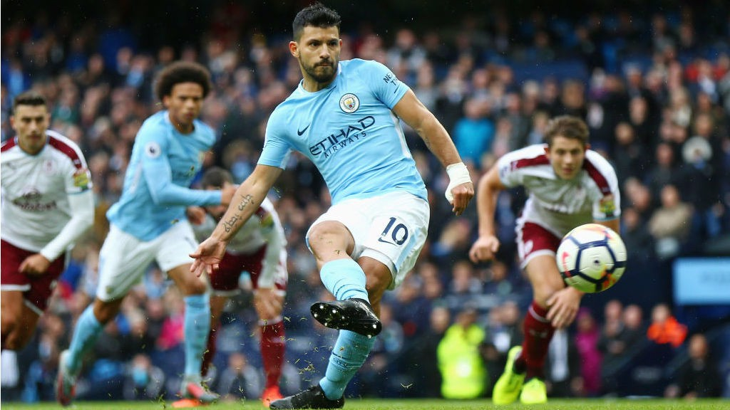 SPOT ON: Sergio Aguero slams home his record-equalling penalty