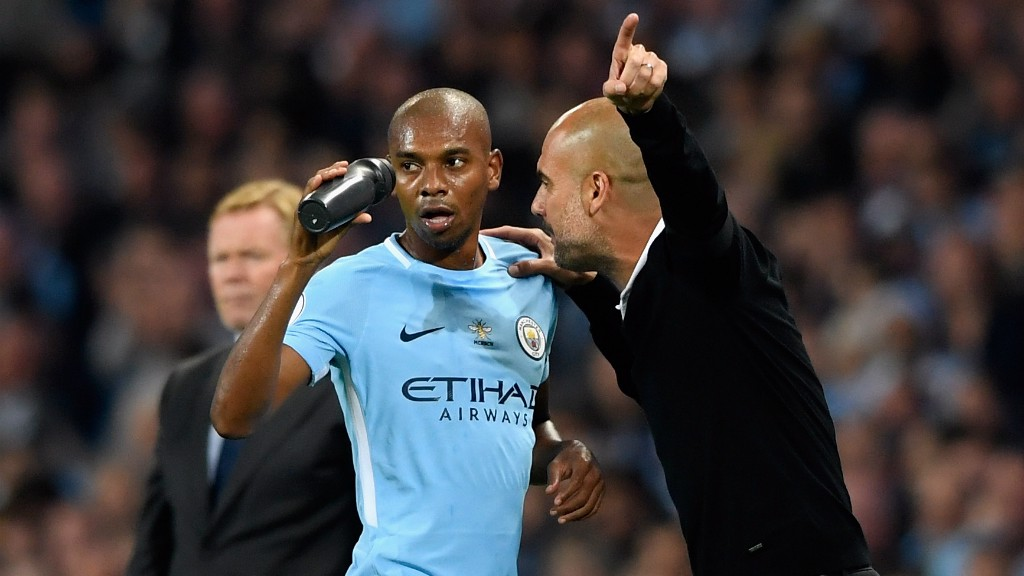 LISTENING CLOSELY: Pep gives instructions to Fernandinho.