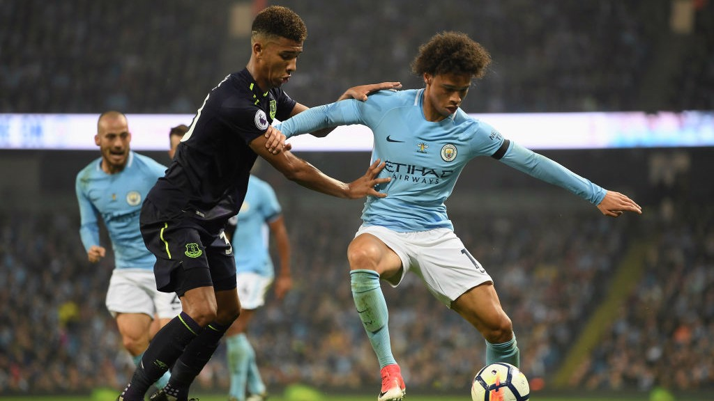 HEAVY PRESSURE: Leroy Sane holds off the challenge from Mason Holgate.