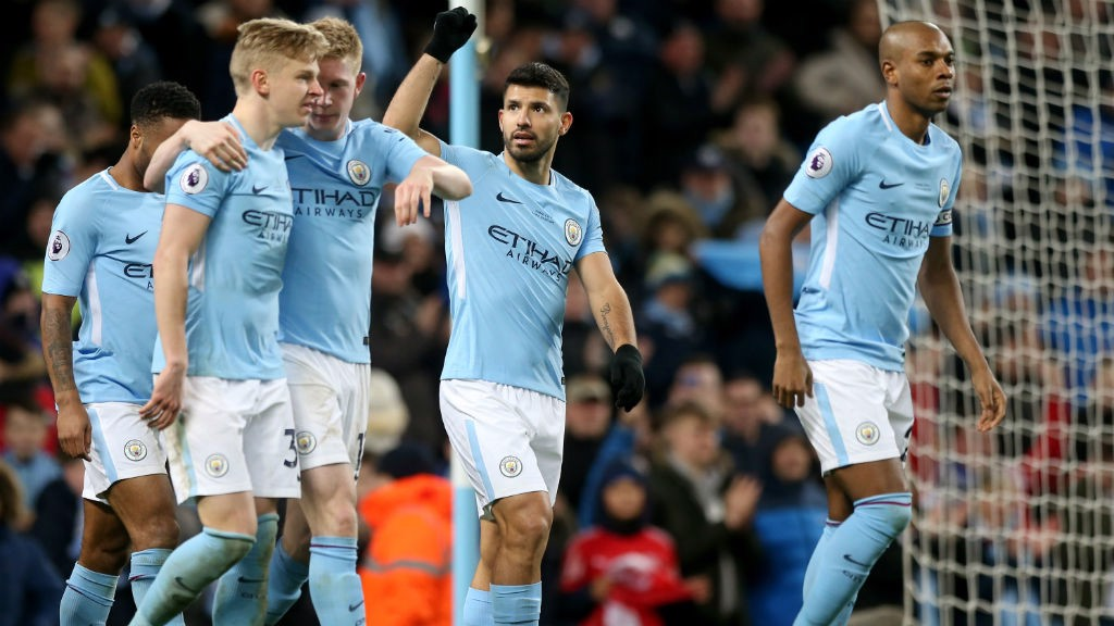 CITY: Aguero cheers along with the fans after scoring a second.