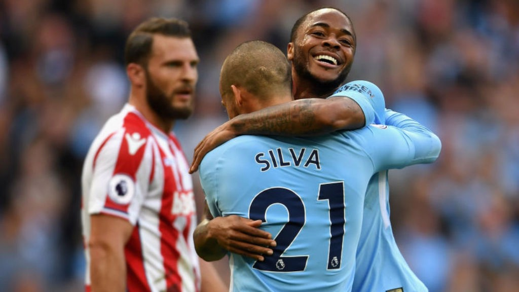 THREE CHEERS: The expression of Raheem Sterling says it all as he celebrates with David Silva after City's third