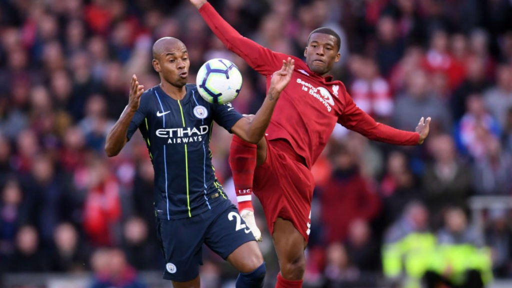 MIDDLE MARCH: Fernandinho battles with Georgino Wijnaldum