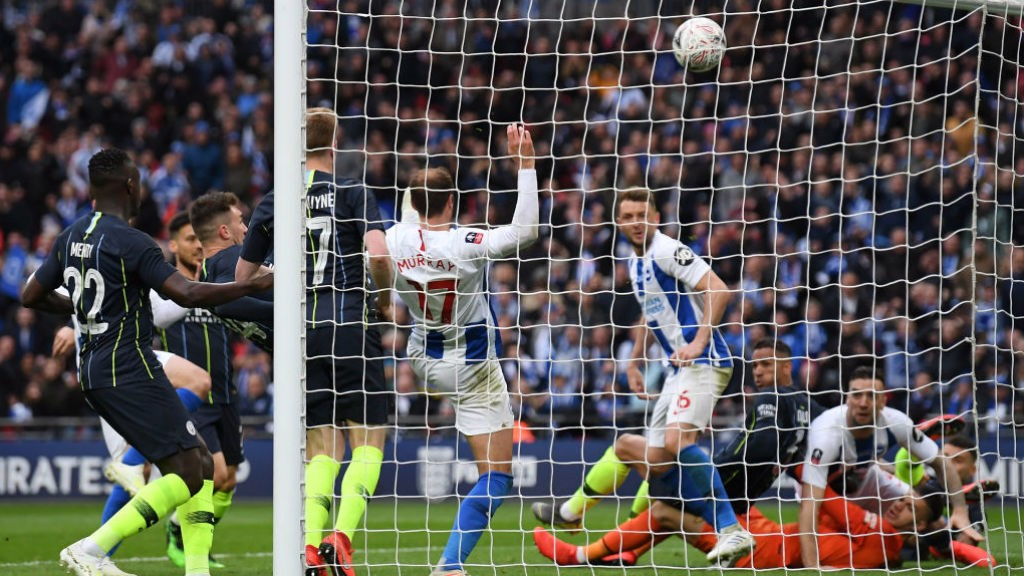 NICK OF TIME: Aymeric Laporte saves a certain goal as he just beats Brighton's Glenn Murray to the ball and clears over the bar