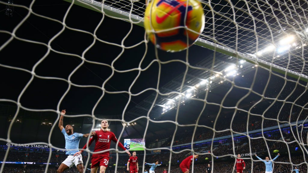 NET GAIN: The ball nestles in the back of the Liverpool goal after Sergio Aguero's wonder goal