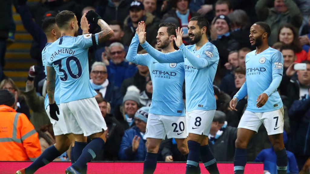 HIGH TENS: The team celebrate Ilkay Gundogan's brilliant header