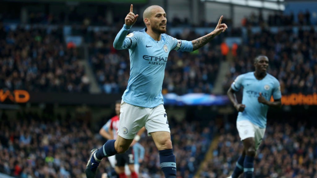 SOLID SILVA: David Silva wheels away in celebration after his superb strike put us 3-0 up