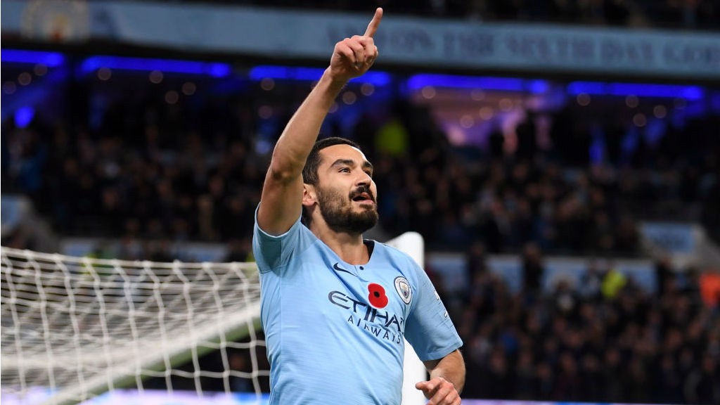 DEMOLITION DERBY: Ilkay Gundogan celebrates after sealing victory for City