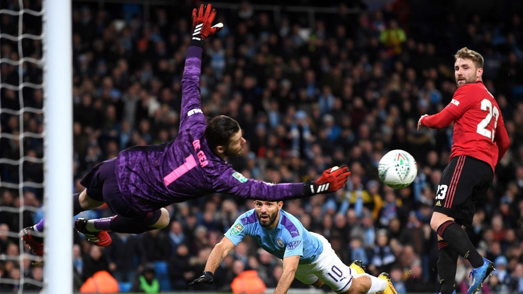 CLOSE: De Gea spectacularly palms away Aguero's accurate header.