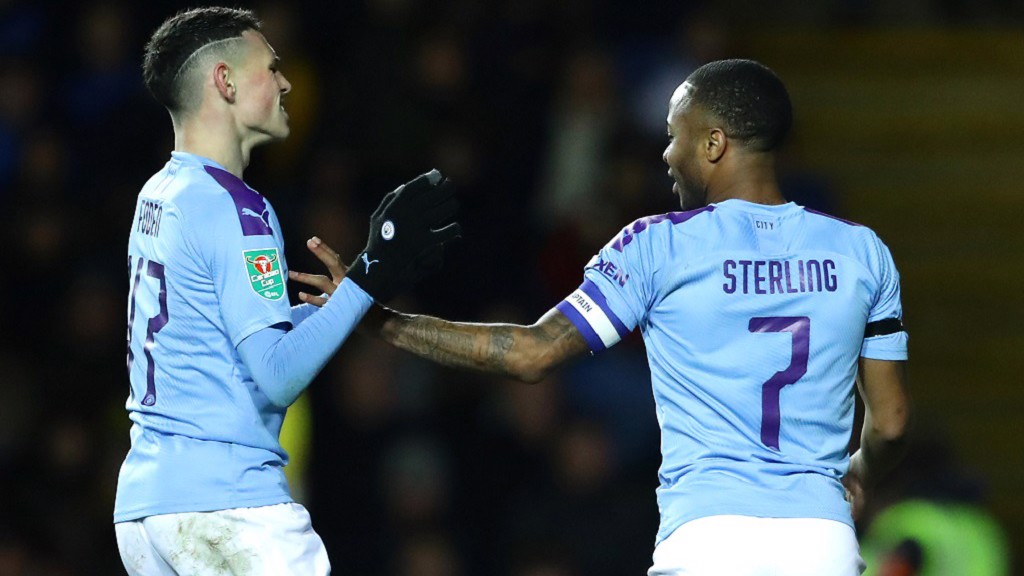 GAME OVER: Foden congratulates the skipper on his second goal