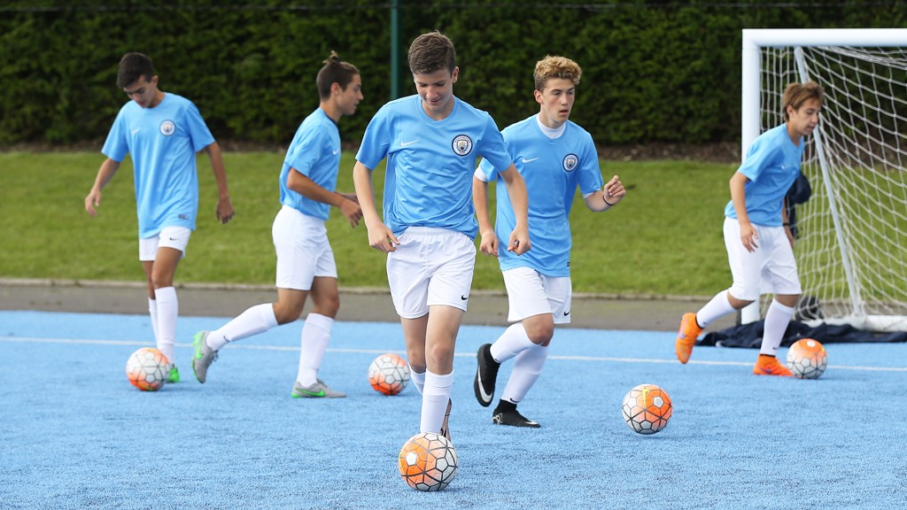 Manchester City's 'City Football Schools' sport their new kit in training at the City Football Academy