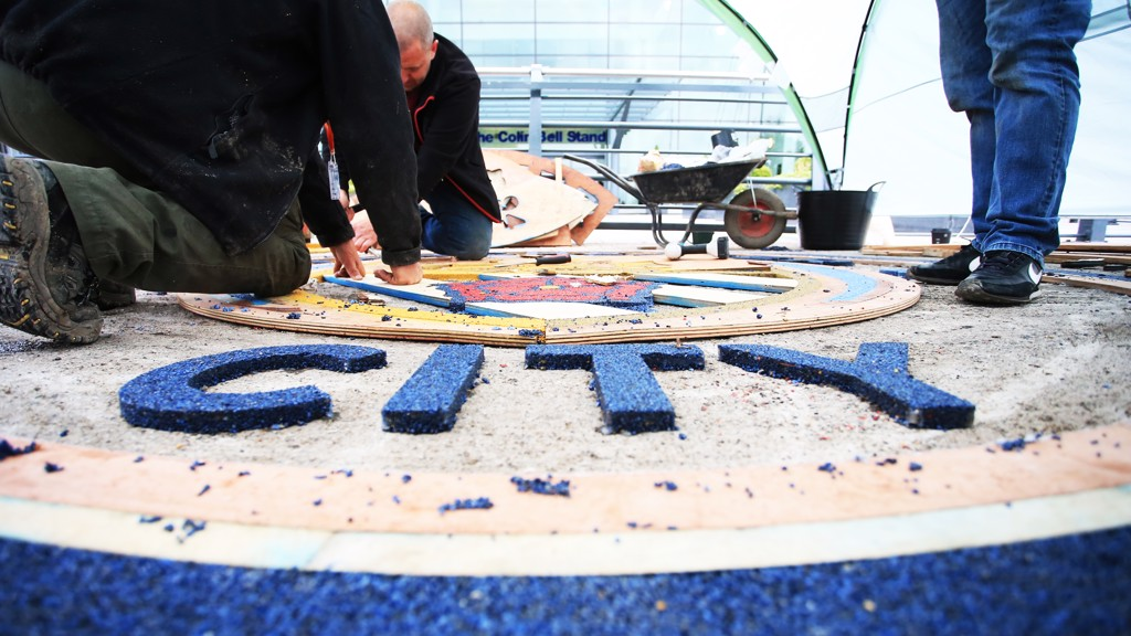 The new Manchester City crest is laid in front of the Etihad Stadium